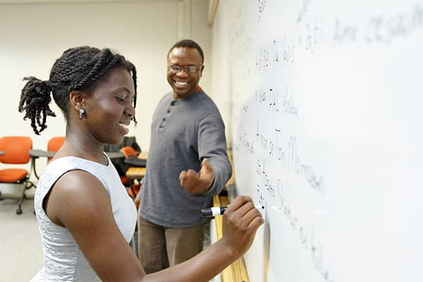Adeolu Ademoyo, senior lecturer, with a student.